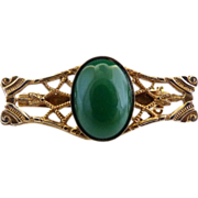Filigree brooch green cabochon center