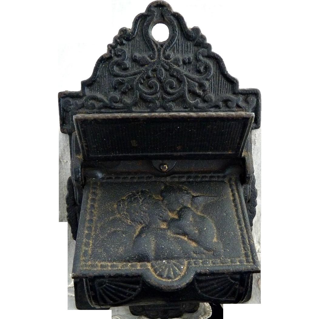 Antique cast iron match holder Venus Cupid c. 1900