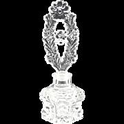 Elegant pressed glass perfume bottle floral stopper