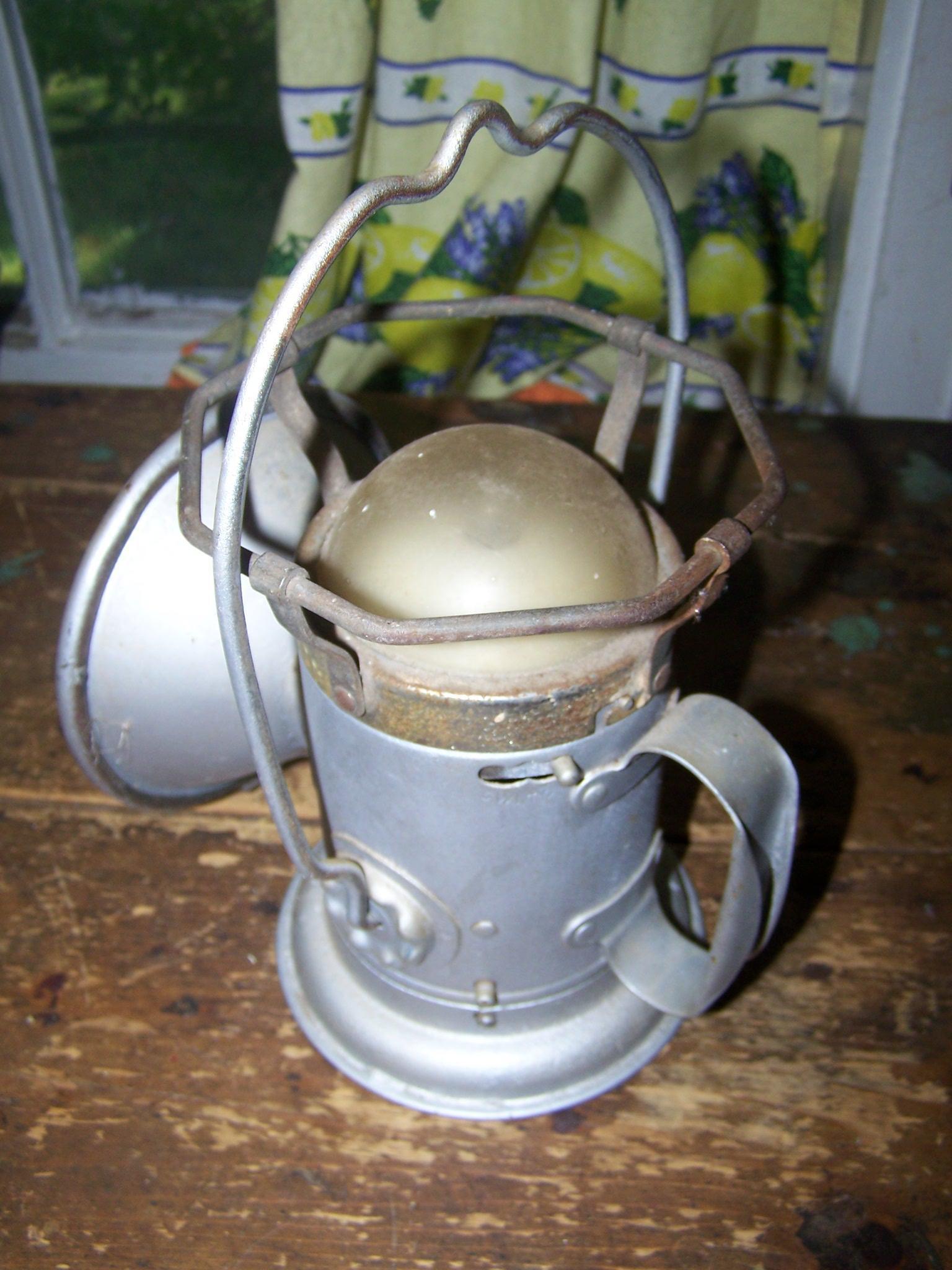 An Old Metal Ware Delta Powerlite Lantern Hand Held