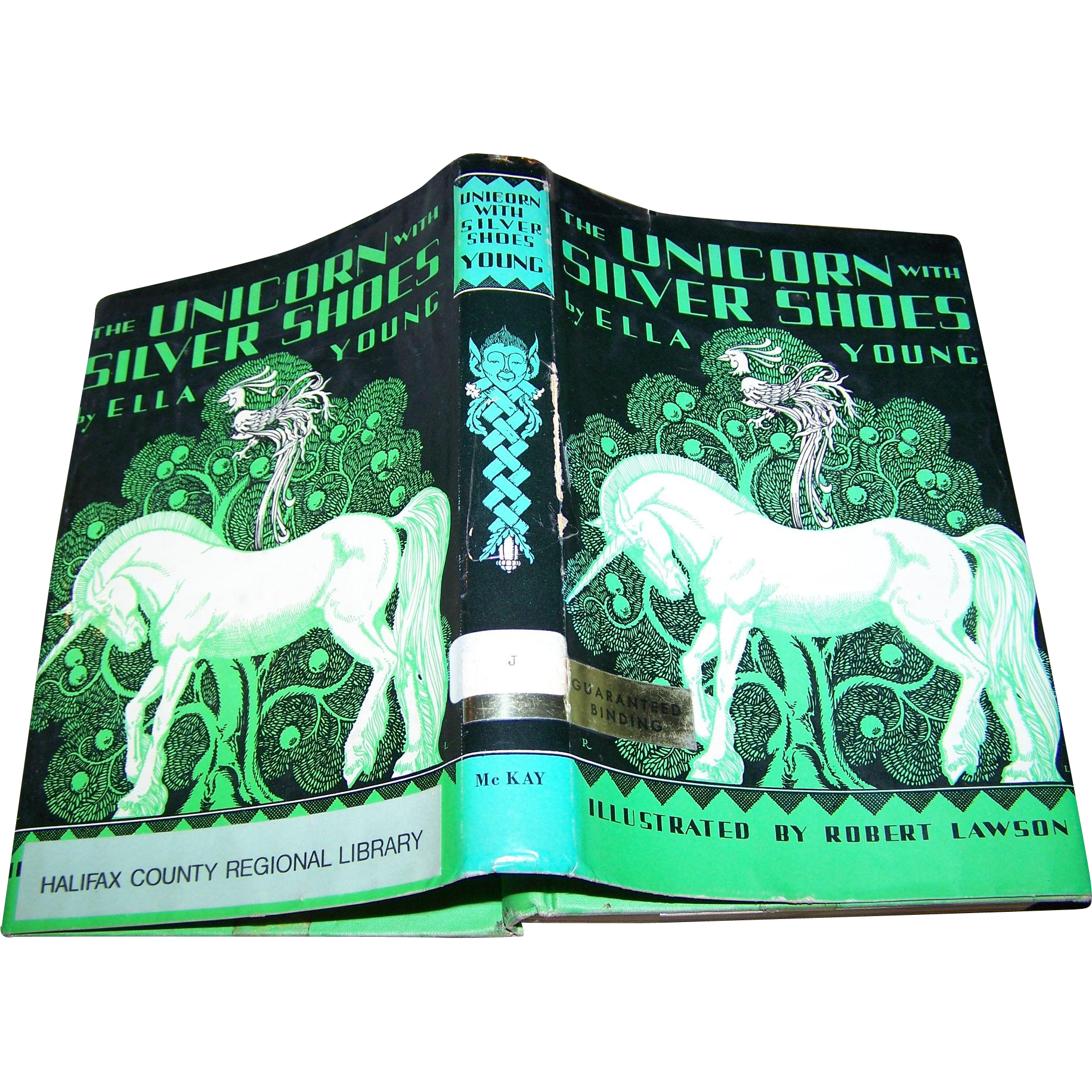 "This Ex Libra Hard Cover Book is Titled "" The Unicorn with Silver Shoes "" by Ella Young"