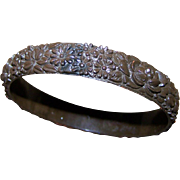 A Delicate Brown Deeply Molded Vintage Bangle Bracelet Mixed Flower Pattern