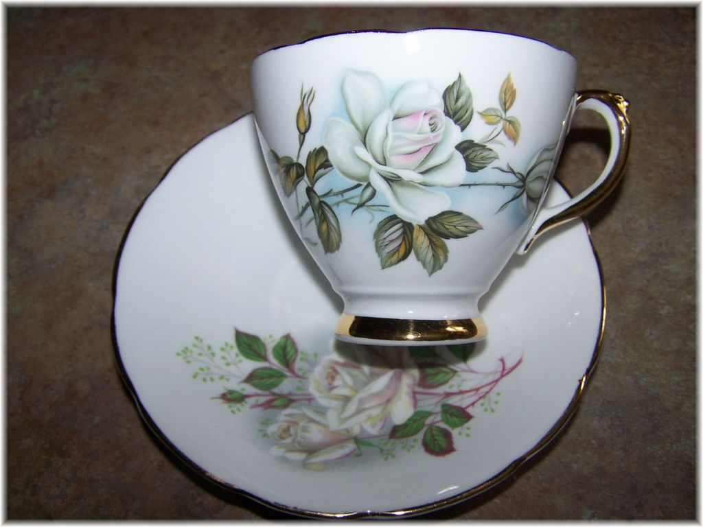 White rose floral motif tea cup saucer delphine sold on for Mode in england