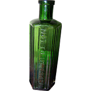 A Great Old Green Glass Poison Embossed Not To Be Taken