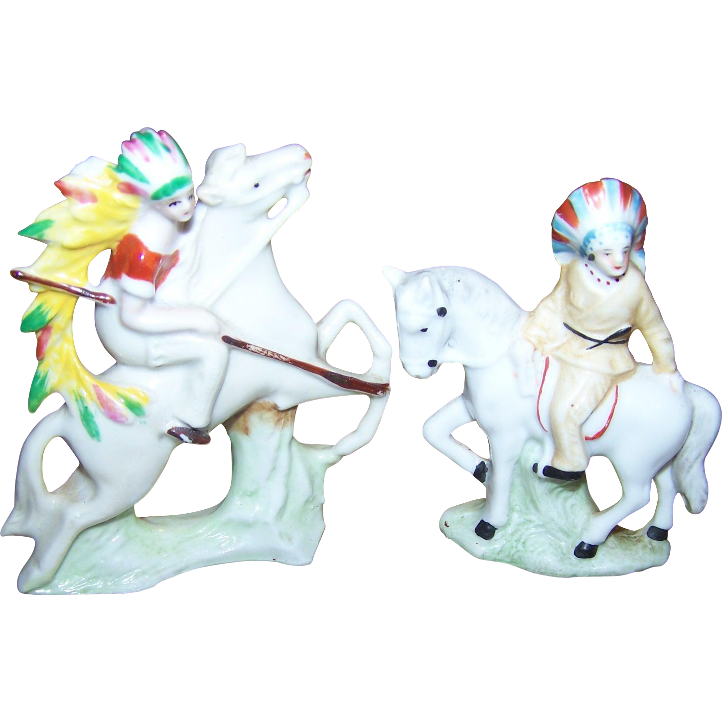 A  Set of Miniature Porcelain Native American Indian Themed Figurines on Horseback Made in Germany