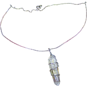 A Gently Used Rock  Crystal Quartz Pendant Necklace with 15 1/2 Inch Sterling Fine Chain