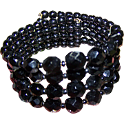 A Lovely Vintage  Four Strand Jet Black Glass Bead Coil  Memory Wrap Mourning  Bracelet