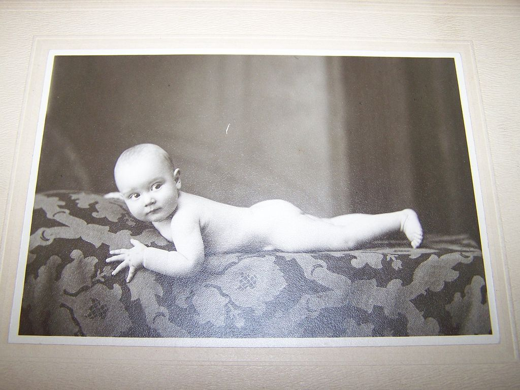 Cute Studio Posed Photograph Baby  Au Naturel