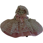 "Miniature Bisque Doll, ......  4"" Tall In Pink Ribbon & Lace , Circa 1900"