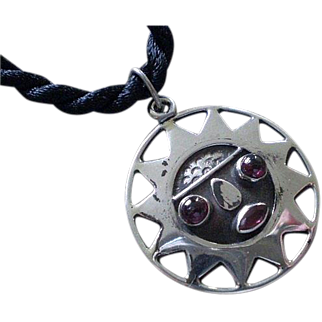 BEJEWELED Ecuadoran Mid-century Handcrafted .925 Silver Pre-Columbian TRIBAL SUN PENDANT with Garnet Gemstone Embellishments