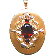 14K Yellow Gold Signed Vintage Two Picture Locket with Three Blood Red Faceted Garnets