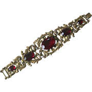 Stunning Vintage Heavy Ornate Carved gold Tone & Red Glass Stones Bracelet