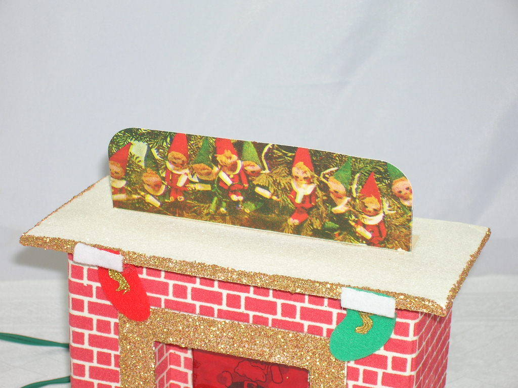 Santa in fireplace pixie elves mantle from rubylane sold on ruby lane