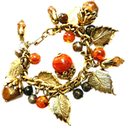 Lots of Noise Charm Bracelet with Acorns, Leaves, Baubles, Vintage 50s