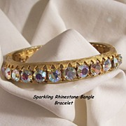 Sensational 24 sparkling Aurora Borealis Rhinestone side open Bangle Bracelet