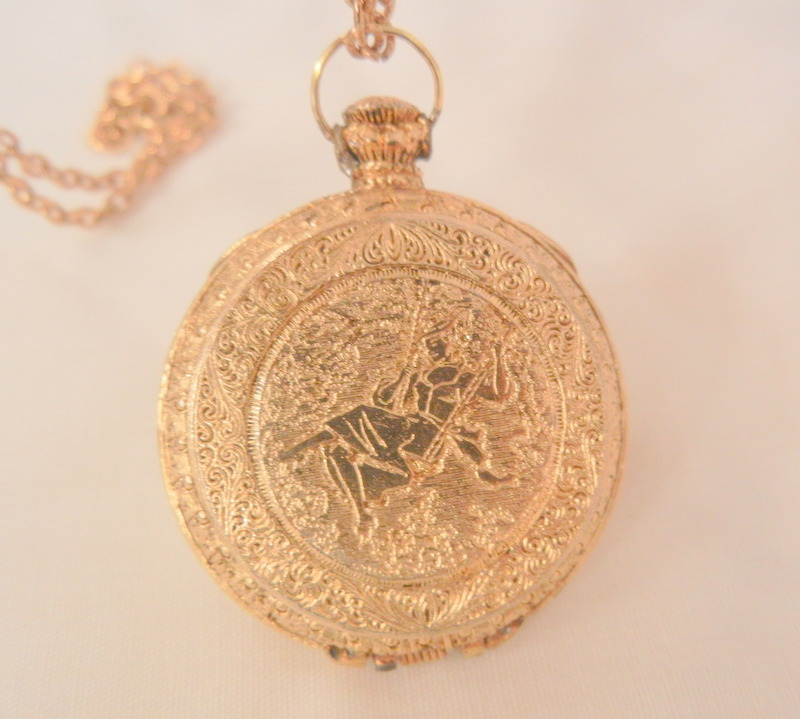 Lovely etched woman on a swing perfume Necklace