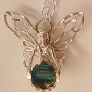 Sterling flying fairy carrying emerald green rhinestone treasure in her dress Necklace
