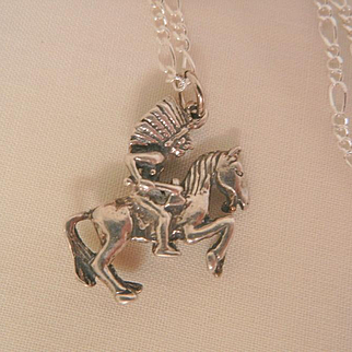 Held for KATY Sterling small Indian chief in full head dress with tomahawk riding a horse Necklace