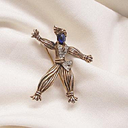 Wonderful Alfred Philippe Trifari Crown Sterling Sapphire colored cabochon pave rhinestone Rintintin Brooch Book Piece 1943