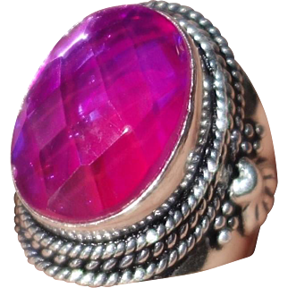 Sterling Silver Ring with Faceted Purplish Pink Center