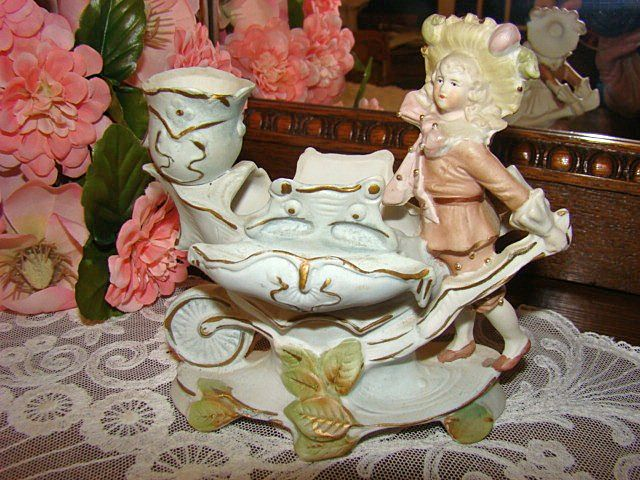 Early Bisque Porcelain Boy and Carrier Vase