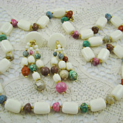 White Lucite and Marbleized Bead Set