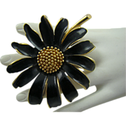 Large Marvella Black Enamel and Gold Tone Flower Brooch