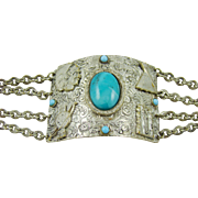 Silver Tone Bracelet with Native American Motif and Faux Turquoise