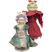 2 German Bisque Dolls with same Molded Bonnets