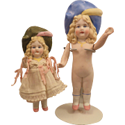 2 German All Bisque Dolls with same Molded Hats