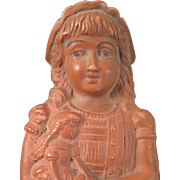 Antique Rubber Doll Holding a Doll
