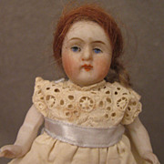 4 inch German All Bisque Doll in Eyelet Dress