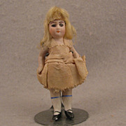 3.5 inch German Glass Eye Blond Wigged All Bisque Doll - all original