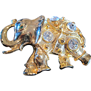 Vintage rhinestone & gold tone metal elephant pin