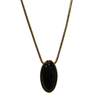 Classic vintage Monet necklace on snakeskin gold tone chain