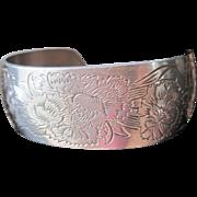 Vintage embossed silver tone metal cuff bracelet