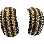 Vintage black and gold tone metal striped clip earrings