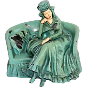 Cast Metal Bookend Doorstop Woman on Sofa