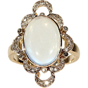 Antique Victorian Moonstone and Diamond Ring with Ornate Frame in 15k Gold