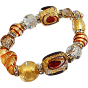 Vintage Art Glass Bracelet. Glass Beads. Handmade Beads. Rhinestone Rondelles. Gold Foil Beads and Red Glass Beads.