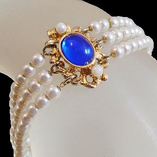 Vintage Pearl with Blue Cabochon Bracelet. Three Strand Pearl Bracelet with Blue Cabochon Accent.