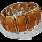 Vintage Brown Moonglow Expansion Bracelet. Allegro. 1950s. Brown Moonglow Lucite Gold Tone Expansion Bracelet.