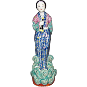 Chinese Late Qing Dynasty Early Republic Porcelain Flute Player