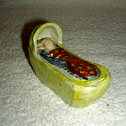 Yellow Glazed Staffordshire Baby in Cradle w/ Red Gown, c. 1800