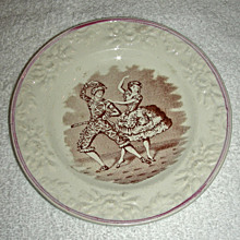 """Staffordshire Child's Plate: """"Harlequin and Columbine"""" w/ Molded Floral Border & Lustre Edge, c. 1860"""