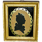 Hollow Cut Silhouette on Silk of a Young Woman in Eglomise Frame c. 1830