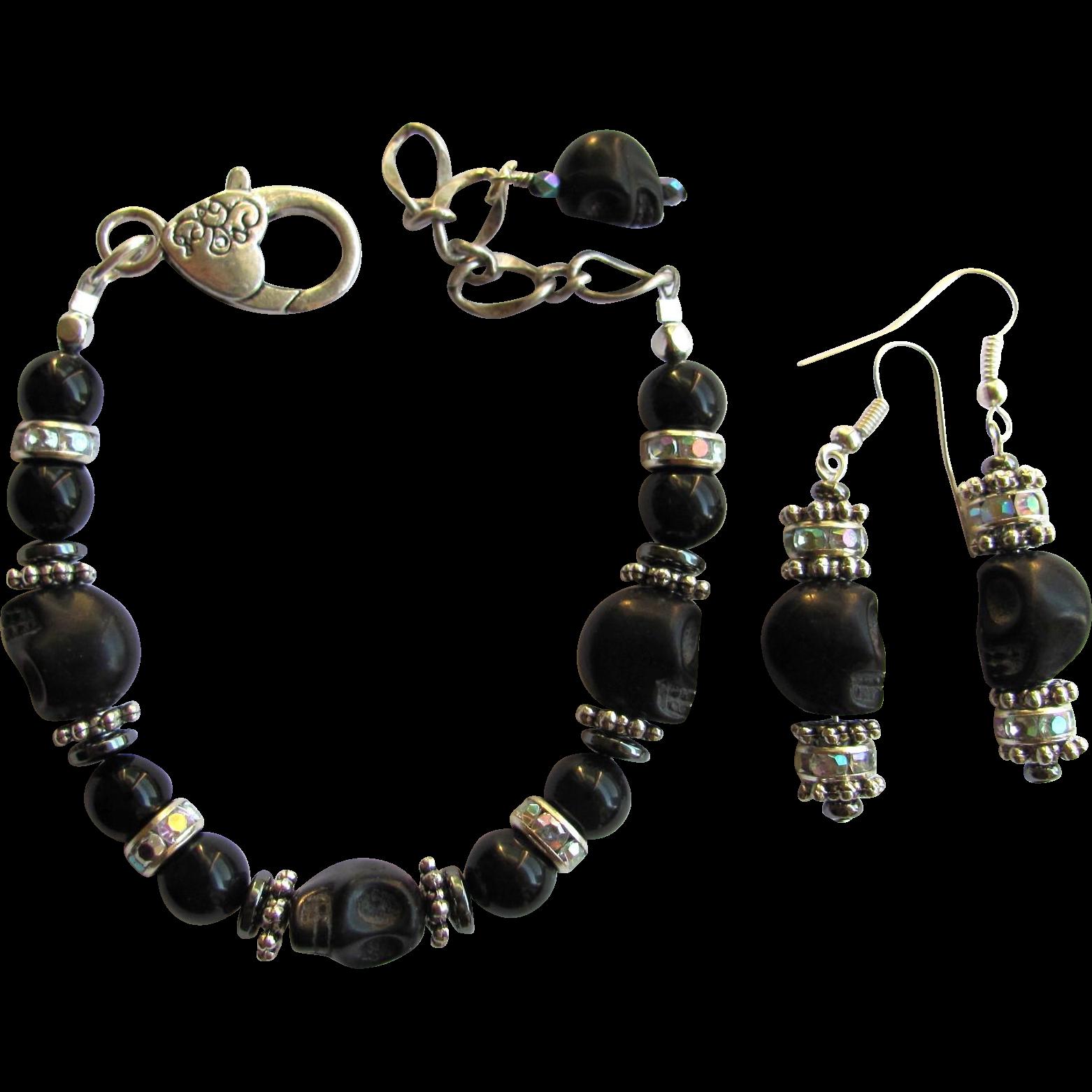black skull bracelet and earrings with sparkling