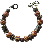 Bracelet with Tiger Stripe and Cheetah Spot Beads with Red Jasper Accent Beads