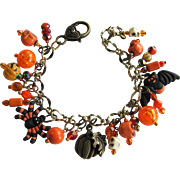 Charm Bracelet with Orange and Black Beads and Halloween Charms with Matching Earrings
