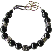 Men's Bracelet of Black Riverstones with Buddha Focal Bead and Elephant Beads